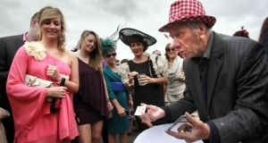 Three Card Trick Man Charlie Clarke plies his trade during Ladies Day at the Galway Races in 2011. Photograph: Brenda Fitzsimons/The Irish Times