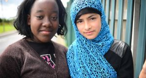 "Friends Natasha  (left) and Minahil, both 12. ""When people [at secondary school] find out where we live, they'll probably bully us . . . Natasha and I, we're best friends. But we won't be able to look after each other all the time."" Photograph: Bryan O'Brien."