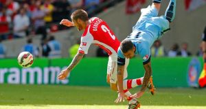 Arsenal's Mathieu Debuchy  is challenged by Manchester City's Aleksandar Kolarov during the  Community Shield  at Wembley Stadium. Photograph: Suzanne Plunkett/Reuters