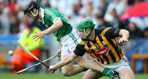 Kilkenny's Paul Murphy battles for possession with Limerick's  Graeme Mulcahy at Croke Park yesterday. Photograph: Inpho