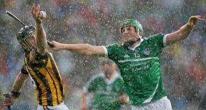 Kilkenny's JJ Delaney battles with Limerick's Shane Dowling in the difficult conditions at Croke Park. Photo: Donall Farmer/Inpho