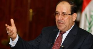 Nuri al-Maliki  delivered a tough speech indicating he would not cave in to pressure to drop a bid for a third term. Photograph: Thaier al-Sudani/Files/Reuters