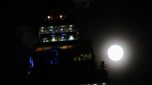 The supermoon rises over the Tower Latinoamericana in Mexico City. The astronomical event occurs when the moon is closest to the Earth in its orbit, making it appear much larger and brighter than usual. Photograph: Reuters/Henry Romero
