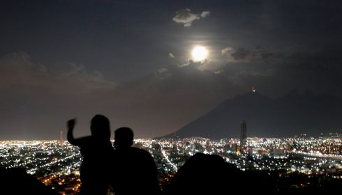 A couple takes a photo in Monterrey. Photograph:  REUTERS/Daniel Becerril