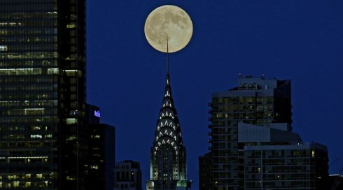The perigee moon, as seen behind the Chrysler Building in New York City from Weehawken, New Jersey.  When the moon is closest to the Earth on its elliptical path, it appears about 14 per cent wider and 30 per cent brighter than at its farthest. The moon reaches a distance of 356,896 km from Earth, the closest in this calendar year.  Photograph: EPA/PETER FOLEY