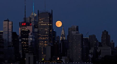 The Big Moon rises over the Big Apple. Photograph: EPA/PETER FOLEY