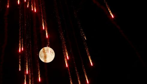 Fireworks in front of the moon outside the town of Mosta, celebrating the feast of its patron saint, in central Malta. Photograph: REUTERS/Darrin Zammit Lupi
