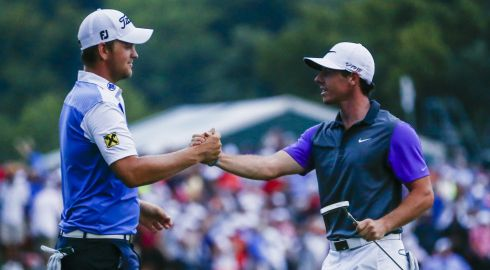 The winner shakes hands with Bernd Wiesberger of Austria (L) after sinking his final putt to win the 96th PGA Championship. Photograph: EPA/TANNEN MAURY