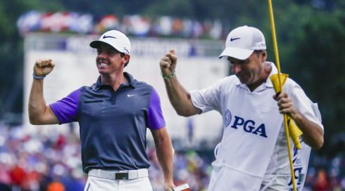 Caddie JP Fitzgerald shares the celebrations.  Photograph: EPA/TANNEN MAURY