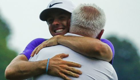 Gerry McIlroy embraces his son. Photograph: EPA/TANNEN MAURY