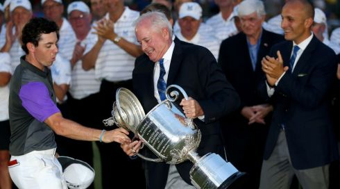 Whoops! Rory McIlroy catches the lid of the Wanamaker trophy as PGA of America President, Ted Bishop, holds the trophy. Photograph: by Andrew Redington/Getty Images