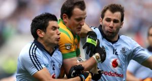 Dublin's Cian O'Sullivan and Bryan Cullen close down Donegal's  Michael Murphy during the 2011 All-Ireland SFC semi-final at Croke Park. Photograph: James Crombie/Inpho