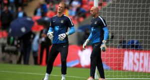 Manchester City goalkeeper Joe Hart warms up with team-mate Willy Caballero prior to Sunday's Community Shield match at Wembley Stadium. Photograph: PA