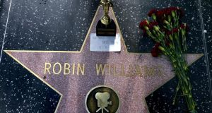 Flowers, an Oscar souvenir and a note reading 'We Miss You RIP' is placed on the Hollywood Walk of Fame star for US actor Robin Williams in Hollywood, California. Photograph: Michael Nelson/EPA