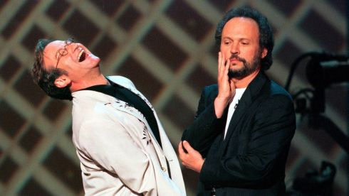 Sharing a laugh with actor Billy Crystal on the stage of New York's Radio City Music Hall in 1998. Photograph: REUTERS/Jeff Christensen