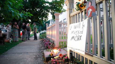 Local residents take in a makeshift memorial for Robin Williams in Boulder, Colorado. The exterior of the house was used in the opening credits for Mork & Mindy, the comedy based in Boulder that catapulted Williams' career. Photograph: Marc Piscotty/Getty Images