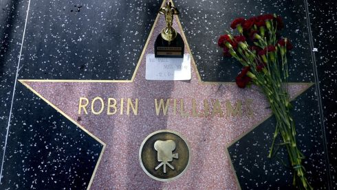 Flowers and an Oscar souvenir are placed on the Hollywood Walk of Fame star . Photograph: EPA/MICHAEL NELSON