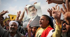 Supporters of Mohammed Morsi protest outside his trial in Cairo in November 2013. Photograph: Tara Todras-Whitehill/The New York Times
