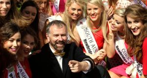 Host Dáithí Ó Sé with some of the 32 Irish and International Roses taking part in the 2014 International Rose Selection at the launch of this year's Rose of Tralee Festival at Dublin Airport. Photograph:  Brian Lawless/PA
