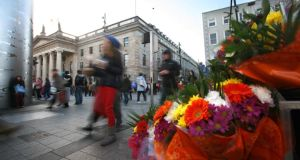 Flower sellers beside the Spire, on O'Connell Street, Dublin. File photograph: Dara Mac Dónaill / The Irish Times.