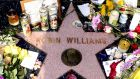 Flowers and tributes are placed at the make-shift memorial on the Hollywood Walk of Fame star for US actor Robin Williams, who was found dead of an apparent suicide in his Tiberon home north of San Francisco yesterday. Photograph: Michael Nelson/EPA