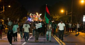 Demonstrators march in the street while protesting the shooting death of black teenager Michael Brown in Ferguson, Missouri . Photograph: Mario Anzuoni/Reuters