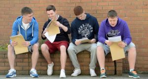 Jordan Lawless, Cain Rooney, James Broughal and Sean Cardiff opening their Leaving Certificate results at St John's De La Salle College, Ballyfermot, Dublin this morning. Photograph: Frank Miller / The Irish Times