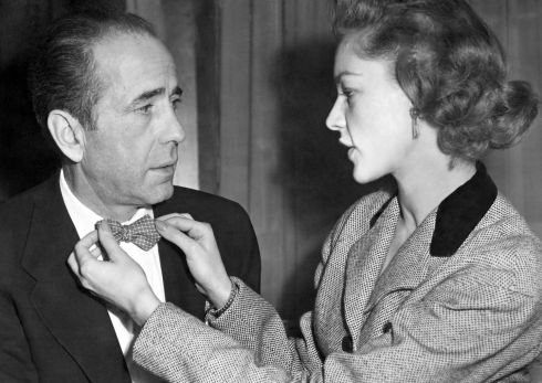 Bacall aged 27 adjusting the bowtie of her husband Humphrey Bogart at a reception in Claridge's Hotel, London. Photograph: Press Association