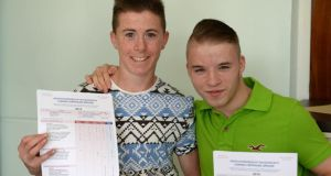 Jordan Byrne (left) and Mark Gillespie getting their Leaving Certificate results at St John's De La Salle College, Ballyfermot, Dublin. Photograph: Frank Miller / The Irish Times