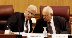 Palestinian chief negotiator Saeb Erekat (left) talks with Arab League chief Nabil el-Araby during their meeting at the Arab League in Cairo on Monday. Photograph: Asmaa Waguih/Reuters