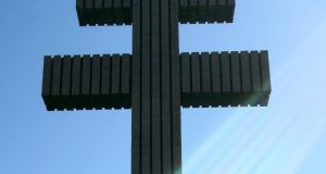 The Cross of Lorraine towers over De Gaulle's grave at Colombey-les-deux-Églises. Photograph: AP