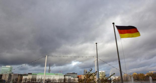 The German national flag flies beside the River Alster in Hamburg. The German economy suffered a surprise contraction in the second quarter, its first in more than a year. Photo: Bloomberg