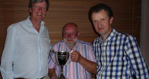Chipping away: John Holstead (centre) winner of Lough Currane sea trout competition, with Michael Roden (chairman, left) and Kevin O'Sullivan (secretary)