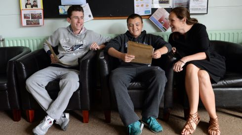 Gavin McClean and David Tyrrell with principal Ann Marie Leonard getting their Leaving Certificate results atSt John's De La Salle College, Ballyfermot, Dublin. Photograph: Frank Miller/The Irish Times