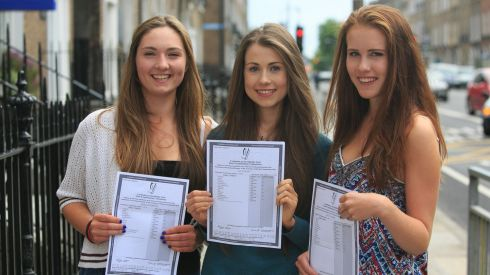 Students from The Institute of Education (left to right) Rebecca Gordon from Shankill, Enya Drudy from Terenure, Emily O'Rourke from Cellbridge celebrate their Leaving Cert Results on Leeson Street, Dublin. Photograph: Gareth Chaney/Collins