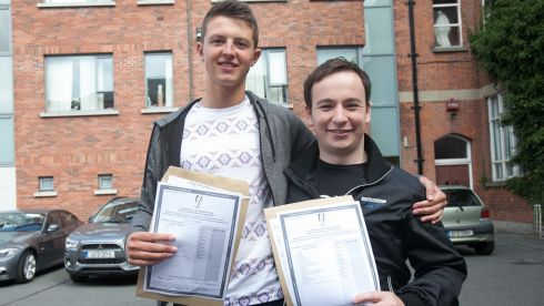 Daniel O' Brien (left) from Griffith Avenue & Iarlath Doherty from Hollystown after recieving their Leaving Cert Results at CUS in Dublin's City Centre. Photograph: Gareth Chaney/Collins