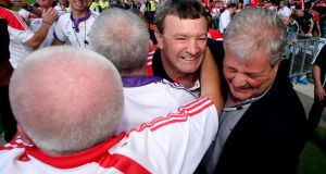 Cork manager Jimmy Barry-Murphy celebrates with his back room team and Cork County Board chairman Bob Ryan after beating Limerick. Photograph: James Crombie/Inpho