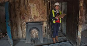 A conservation research officer for Dublin City Council in a 1664 house on Aungier Street, Dublin, that is being restored. Photograph: Brenda Fitzsimons/The Irish Times