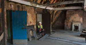 Carl Raftery, a conservation research officer with Dublin City Council, in the 17th century house on Aungier Street, Dublin which is being restored. Photograph: Brenda Fitzsimons