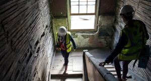 Carl Raftery, a  conservation research officer with Dublin City Council,   with reporter Olivia Kelly in the 17th century house on Aungier Street, Dublin, that is being  restored. Photograph: Brenda Fitzsimons
