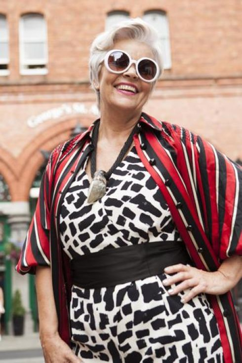 Emer wears raw quartz necklace, Folkster; white round sunglasses, Om Diva; oversized vintage shirt,