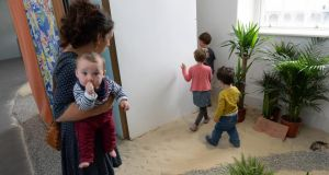 Artistic touch: Sara Keating at Imma with her seventh-month-old baby and two-year-old son. Photograph: Frank Miller