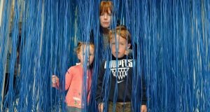 Artistic touch: Jenny Wallblom and her children, Lois and Milo Humphries, exploring Propositions at Imma. Photograph: Frank Miller
