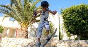 Ramping up: a SkatePal skateboarder in the West Bank. Photograph: Martin O'Grady