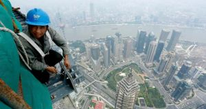 Sky high:  workers have just topped off the Shanghai Tower, currently the world's second-largest skyscraper.  Photograph: Reuters