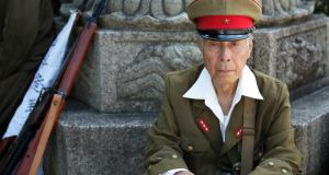 Yoshimitsu Sanada (81), dressed in an army uniform, at the Yasukuni Shrine on Friday. Japanese prime minister Shinzo Abe stayed away from the Tokyo war shrine on the 69th anniversary of Japan's second World War defeat. Photograph: Kiyoshi Ota/Bloomberg