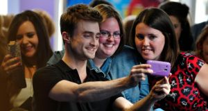 Daniel Radcliffe pictured with fans at the premier of 'What If' in Dublin's Cineworld this evening. Photograph: Aidan Crawley/The Irish Times