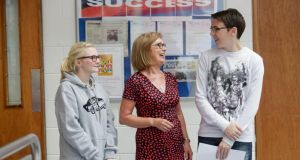 Minister for Education Jan O'Sullivan with Leaving Cert students Stephen Ryan and Jenny O Connor as they got their results at St Nessan's Community College in Limerick. Photograph: Brian Arthur/Press 22