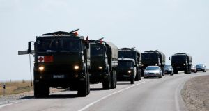 Russian military vehicles drive along the road outside Kamensk-Shakhtinsky, Rostov Region, today. Photograph: Reuters