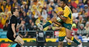 Kurtley Beale (right) of Australia receives a kick against New Zealand  during their Rugby Championship match in Sydney. Photograph: Jason Reed / Reuters